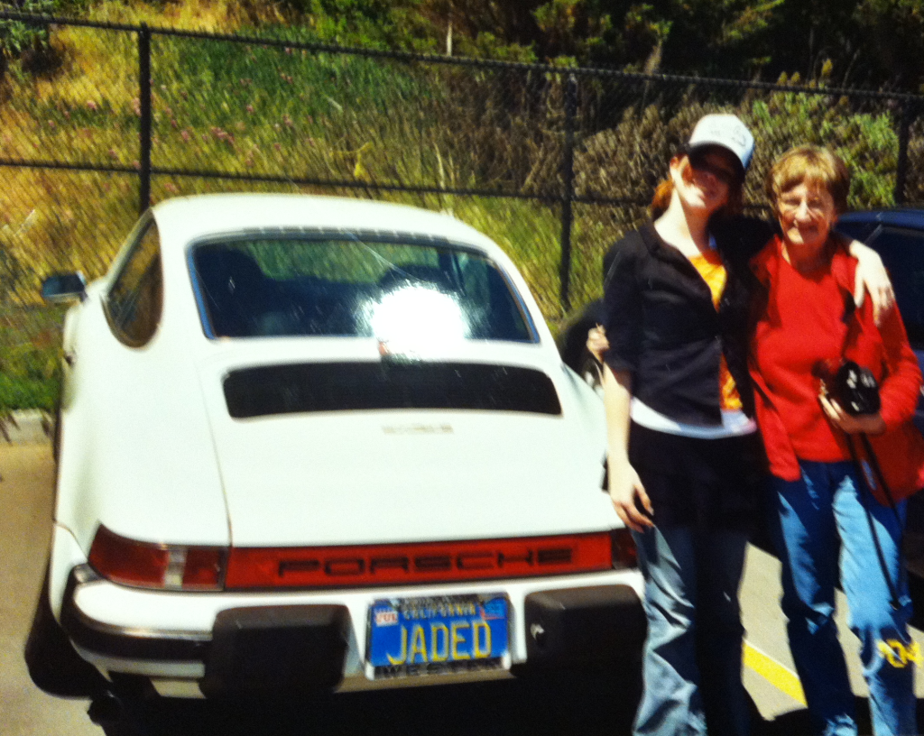 16 year old Missy with my Aunt Nancy (and her awesome car).